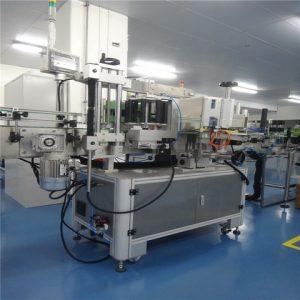 Màquina d'impressió d'etiquetes amb cola humida