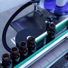 Detalls de la màquina d'etiquetatge d'adhesius d'ampolla rodona vertical automàtica